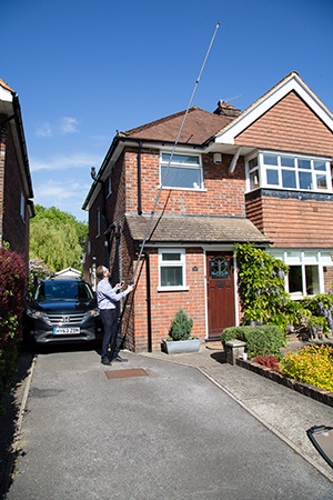 Matthew Brown, Director, surveying a property in Surrey