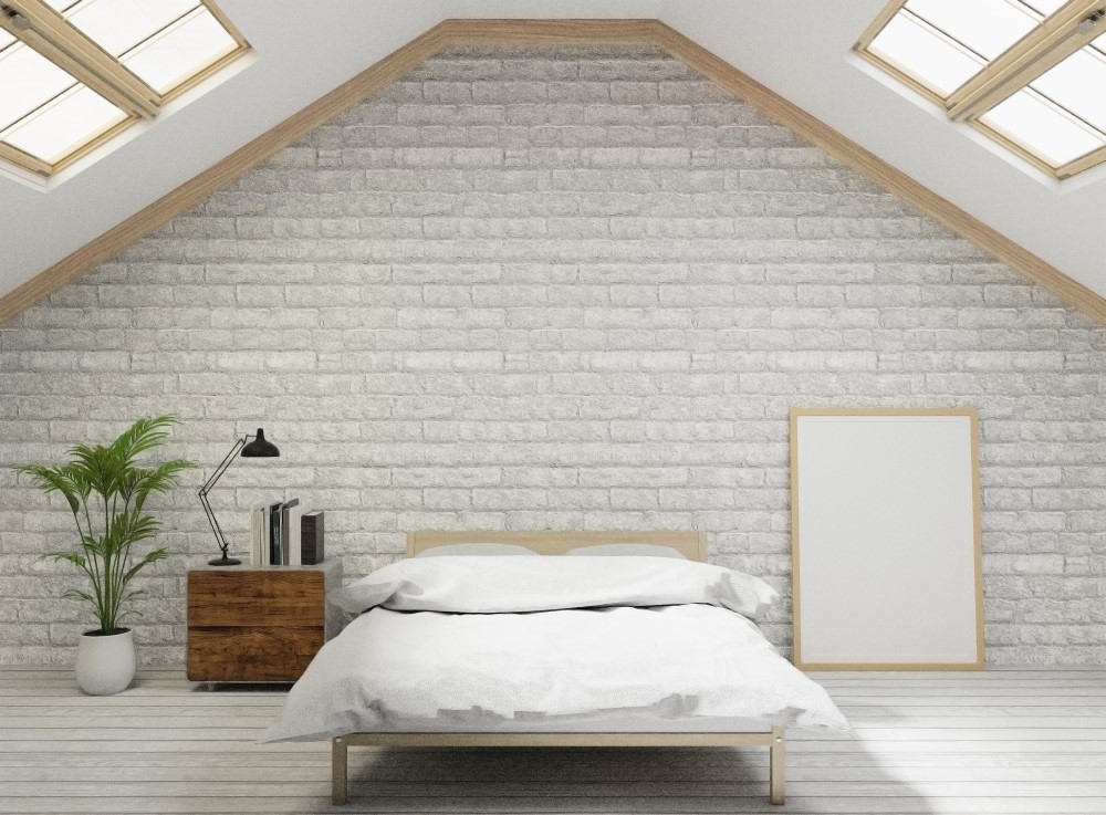 Loft with skylights and white brick walls